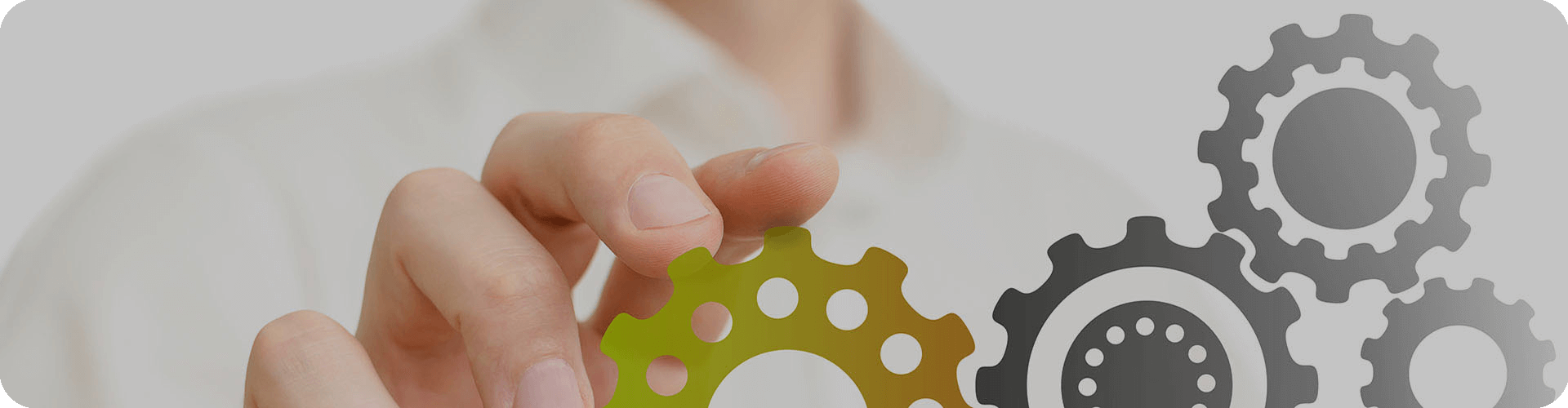 a hand moving a coloured cogs