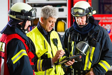firefighters using a tablet