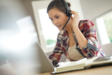 Customer service representative working from home on laptop
